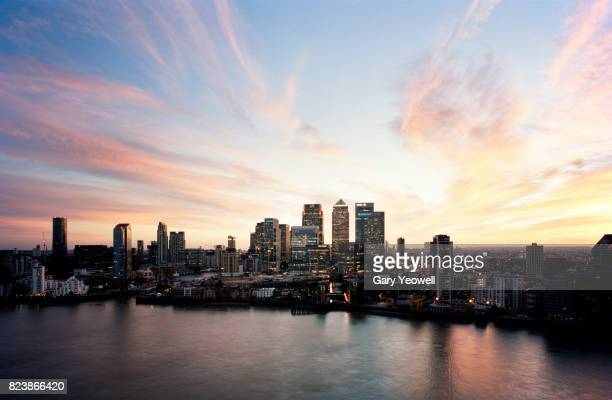 aerial view over canary wharf skyline in london - dusk stock pictures, royalty-free photos & images