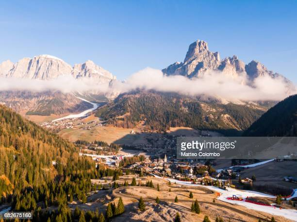 aerial view over corvara town, val badia, dolomites - alta badia stock pictures, royalty-free photos & images