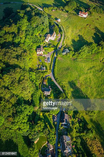 Aerial view over country village idyllic summer landscape green fields