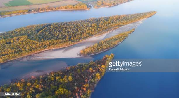 aerial view over danube river at sunset in autumn. - danube river stock pictures, royalty-free photos & images