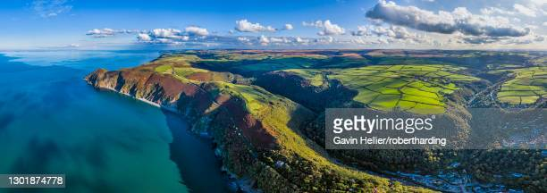aerial view over exmoor national park coastline, lynton and lynmouth, north devon, england, united kingdom, europe - gavin hellier stock pictures, royalty-free photos & images