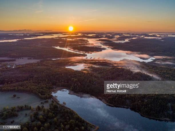 aerial view over foggy lake - coastline stock pictures, royalty-free photos & images