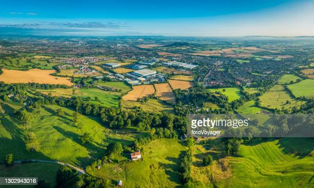 aerial view over green summer fields suburbs town and factories - gloucester england stock pictures, royalty-free photos & images