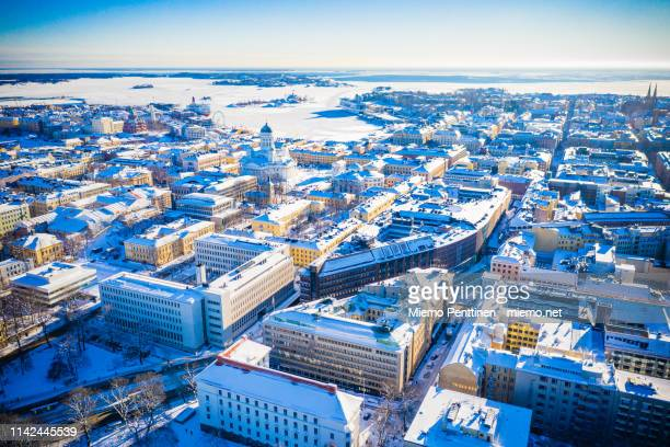 aerial view over helsinki on a sunny winter day - helsinki foto e immagini stock