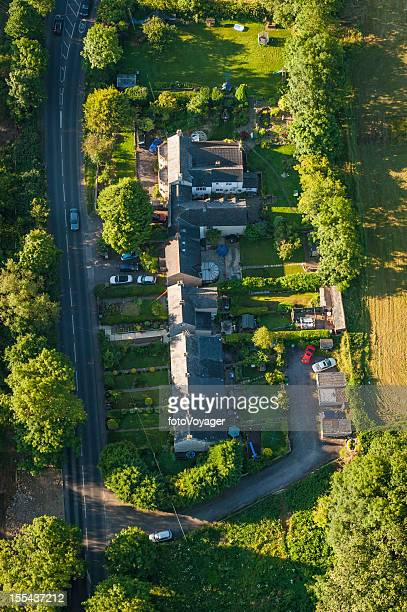aerial view over homes green gardens country road - overhemd en stropdas stock pictures, royalty-free photos & images