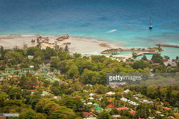 aerial view over idyllic tropical island blue lagoon seychelles - la digue island stock pictures, royalty-free photos & images