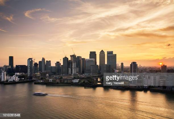aerial view over london canary wharf skyline at sunset - canary wharf stock photos and pictures