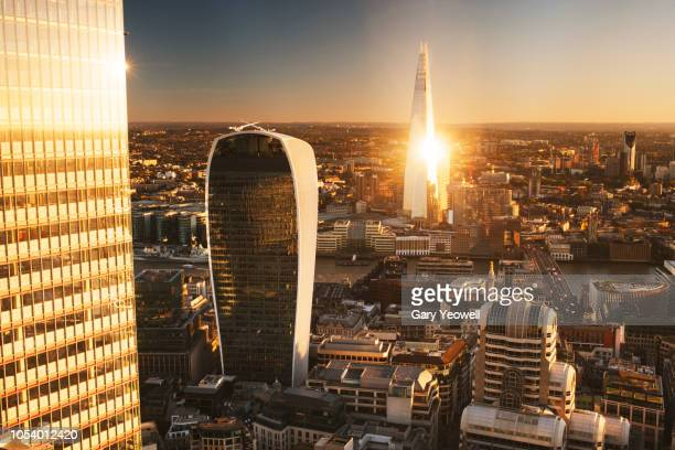 aerial view over london financial district skyline - london skyline stock pictures, royalty-free photos & images