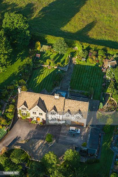 Aerial view over luxury country home and gardens