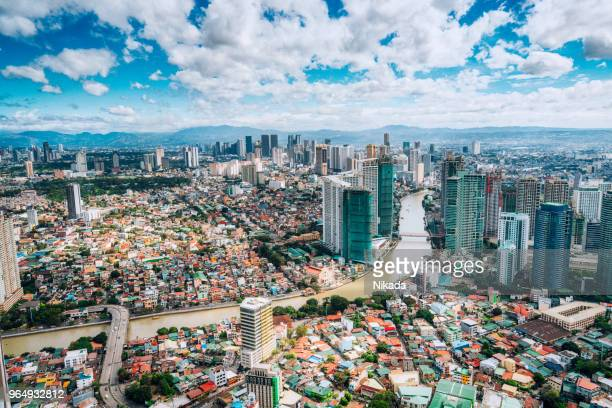 aerial view over makati skyline, metro manila, philippines - makati stock photos and pictures