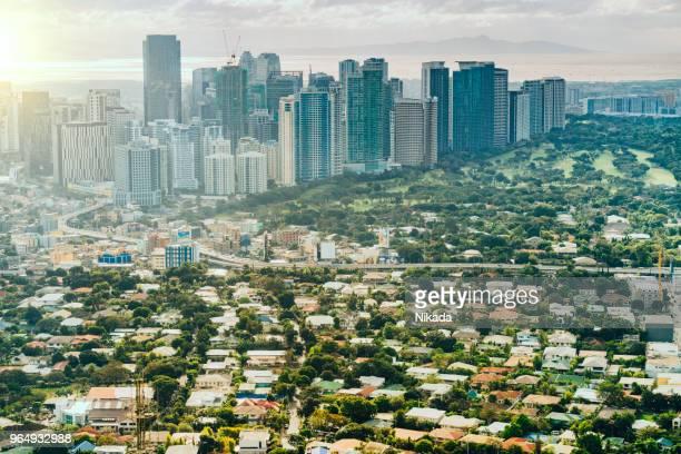 aerial view over makati skyline, metro manila, philippines - metro manila stock photos and pictures