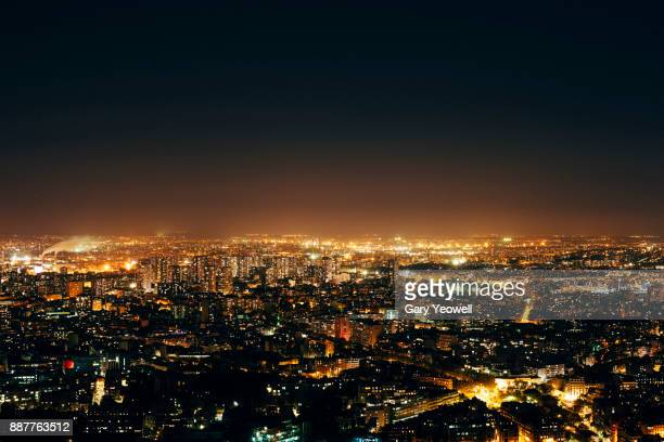 Aerial view over Paris skyline at night