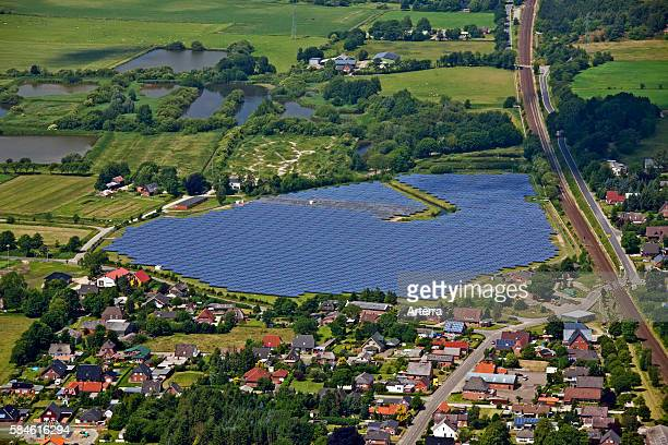 Aerial view over photovoltaic power station / solar park for the supply of merchant power into the electricity grid Germany