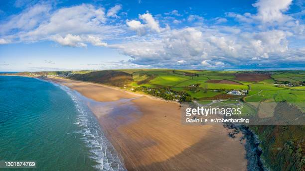 aerial view over putsborough beach towards woolacombe, morte bay, north devon, england, united kingdom, europe - gavin hellier stock pictures, royalty-free photos & images