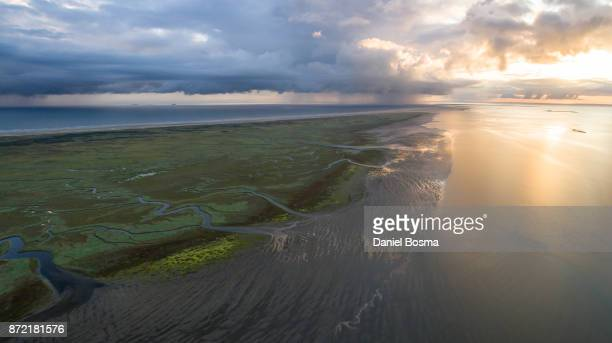 Aerial view over Schiermonnikoog island during a stunning sunrise with a spectacular sky