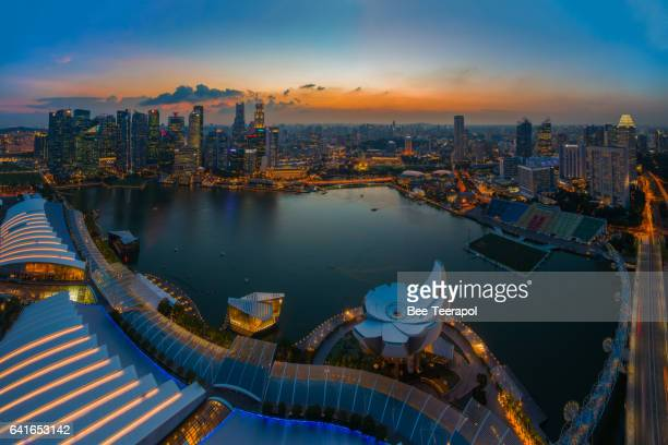 aerial view over singapore marina bay at sunset - marina square stock photos and pictures