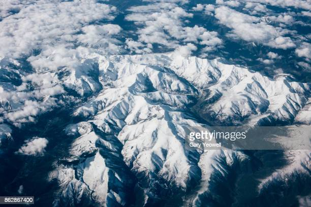 Aerial view over snowcapped mountains