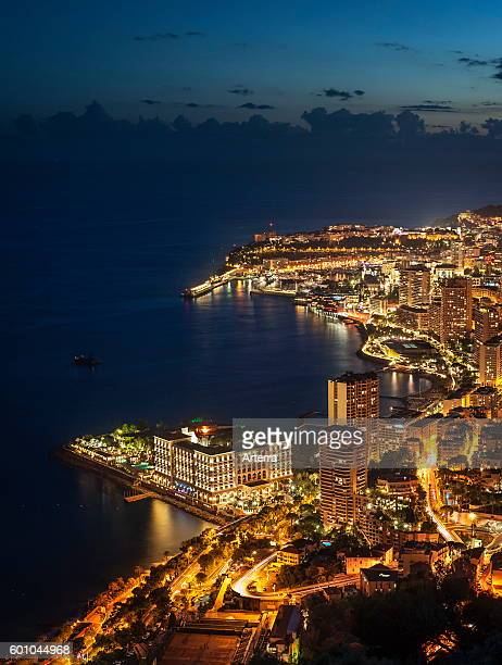 Aerial view over the city and port of Monte Carlo Monaco along the French Riviera at night