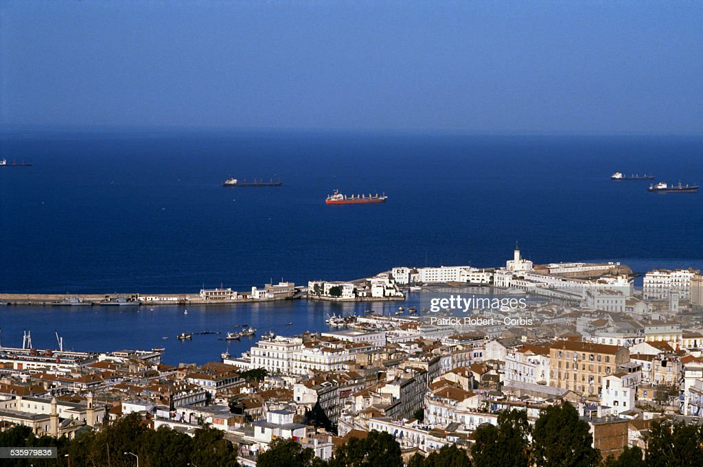 Aerial view over the city of Algiers and the blue waters of the Mediterranean.