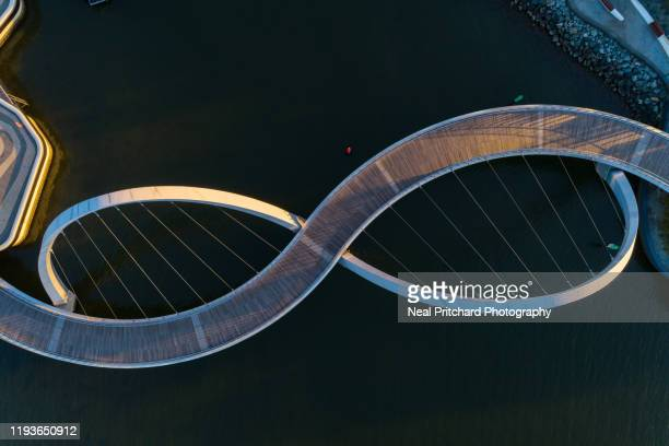 aerial view over the footbridge at elizabeth quay perth western australia - perth australia stock pictures, royalty-free photos & images