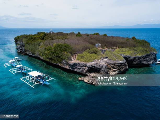 aerial view over the sea around moalboal, cebu island, philippines - cebu stock photos and pictures
