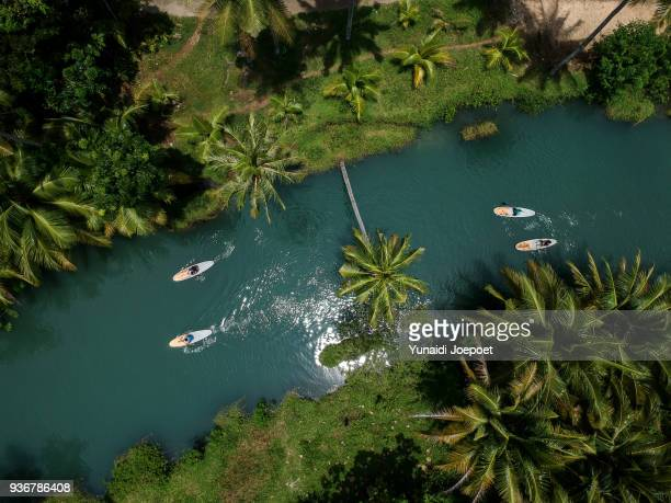 aerial view paddling at cokel river pacitan, east java - indonesia - indonesien stock-fotos und bilder