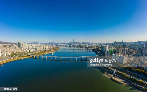 aerial view panorama of seoul downtown city skyline with vehicle on expressway and bridge cross over han river with blue sky and clouds in seoul city, south korea - seoul stock pictures, royalty-free photos & images