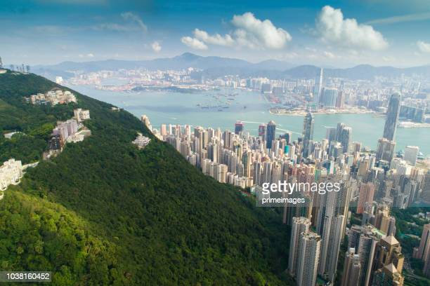 aerial view panoramic of the hong kong city skyline and victoria harbour at sunset at china - hongkong stock pictures, royalty-free photos & images