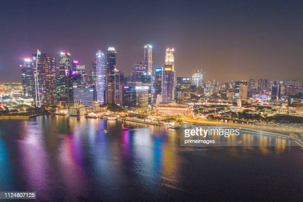 aerial view panoramic of the singapore skyline and marina bay, the marina is the centre of the economy in singapore, there are here all the building in singapore central - marina bay sands skypark stock pictures, royalty-free photos & images
