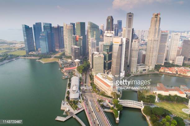 aerial view panoramic of the singapore skyline and marina bay, the marina is the centre of the economy in singapore, there are here all the building of all the majors bank and insurance. - marina bay singapore stock pictures, royalty-free photos & images