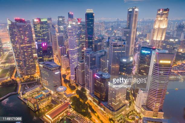 aerial view panoramic of the singapore skyline and marina bay, the marina is the centre of the economy in singapore, there are here all the building in singapore central - singapore city stock pictures, royalty-free photos & images