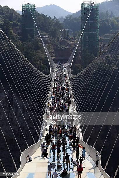 Aerial view photo shows tourists visiting on the glassbottom bridge at Zhangjiajie Grand Canyon on August 20 2016 in Zhangjiajie Hunan Province of...