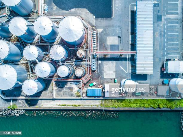 aerial view. piping and tanks of industrial factory - fuel and power generation stock pictures, royalty-free photos & images