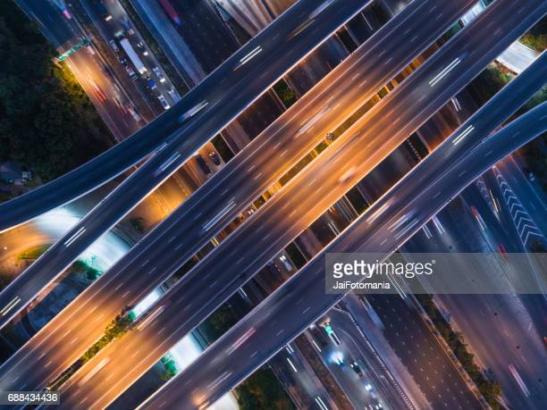 Aerial view Road, Expressway with car lots in the city in Thailand. Street large beautiful downtown. cityscape. Top view.