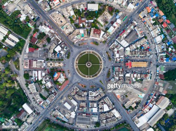 Aerial view Road roundabout with car lots in the city in Thailand cityscape
