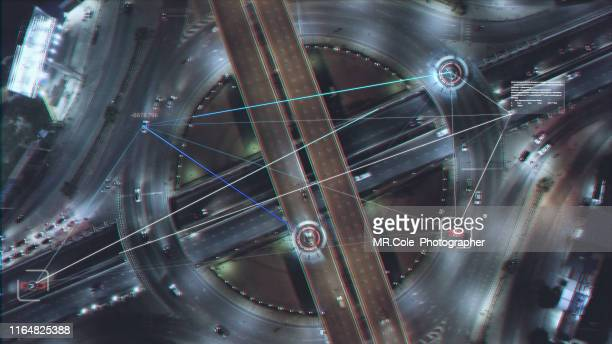 aerial view road traffic with technology hud multi path visual tracker target,connection technology - hud graphical user interface stock photos and pictures