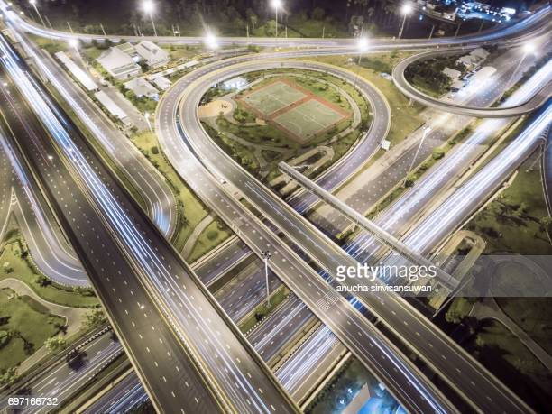 Aerial view roundabout road have public park at night , top view , thailand .