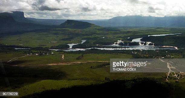 Aerial view September 13 2009 of the tepuy region and small falls near the Angel Falls the world's highest waterfall with a height of 979 m near the...
