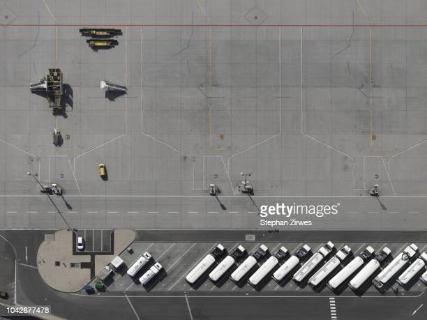aerial view service vehicles parked on tarmac at airport - airport tarmac stock pictures, royalty-free photos & images