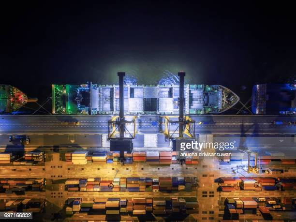 aerial view shipping port crane lifted the containers by sea , thailand . - haut photos et images de collection