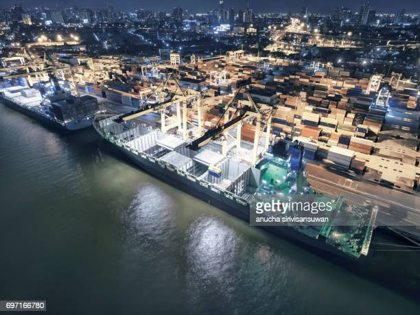 Aerial view Shipping Port crane lifted the containers by sea , Top view , Thailand .