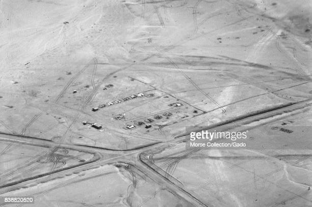 Aerial view shot from an airplane of buildings roadways and tarmacs in the Sinai desert Gaza Israel November 1967