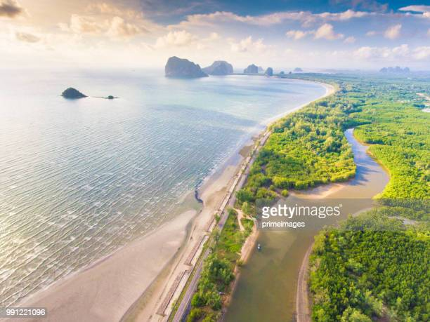 aerial view shot tropical beach sea with long tail boat in south thailand - southeast stock pictures, royalty-free photos & images