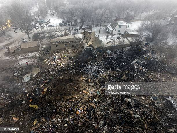 Aerial view show the site of a cargo plane crash near Bishkek Kyrgyzstan on January 16 2017 At least 32 people including six children were killed...