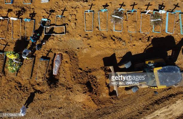 Aerial view showing a coffin being buried at the Nossa Senhora Aparecida cemetery in the neighbourhood of Taruma in Manaus Brazil on June 2 2020...