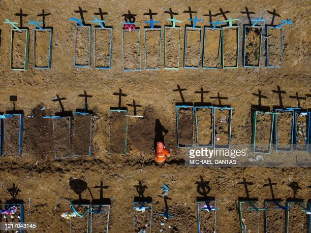 Aerial view showing a gravedigger burying a person at the Nossa Senhora Aparecida cemetery in the neighbourhood of Taruma, in Manaus, Brazil, on June...