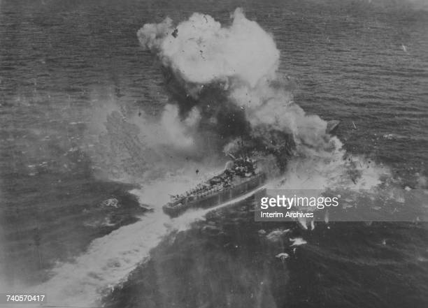 Aerial view showing a Japanese destroyer destroyed by a direct hit while escorting reinforcements to a Japanese garrison at Ormoc Bay, Philippines,...