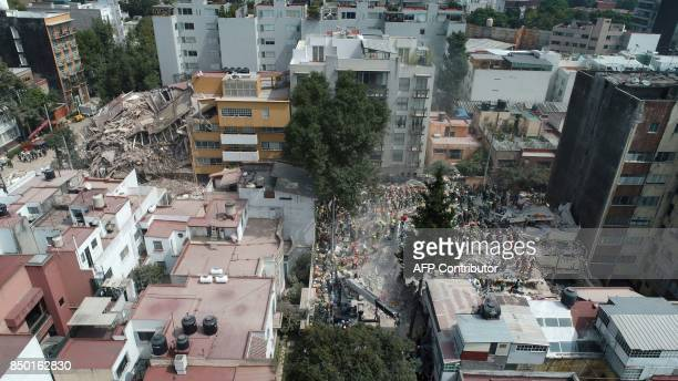 Aerial view showing as rescuers firefighters policemen soldiers and volunteers search for survivors in a flattened building in Mexico City on...