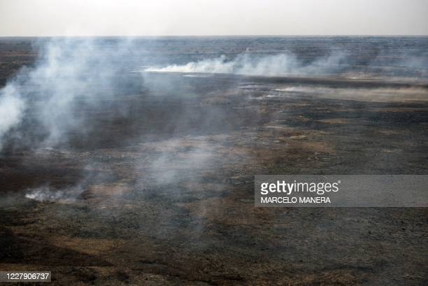 Aerial view showing fire burning on dry wetland in the Parana River Delta in Entre Rios Province, near the Argentine city of Rosario, Santa Fe...
