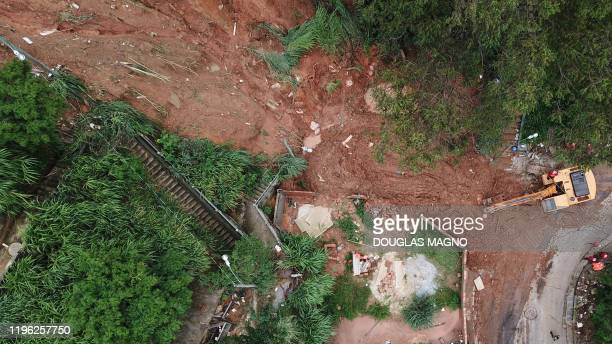 Aerial view showing rescue workers searching for five victims who were buried by a landslide in Jardim Alvorada neighbourhood in Belo Horizonte,...